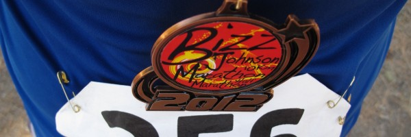 Self-portrait: Bizz Johnson Marathon finisher's medal and bib from runner's point of view