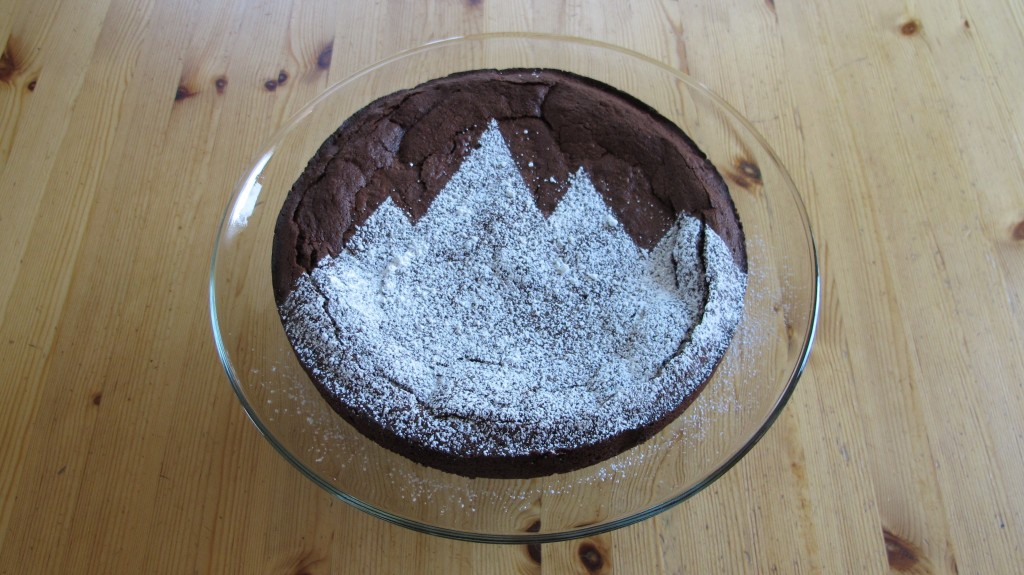 Gluten-free flourless chocolate cake with an easy powdered sugar decoration