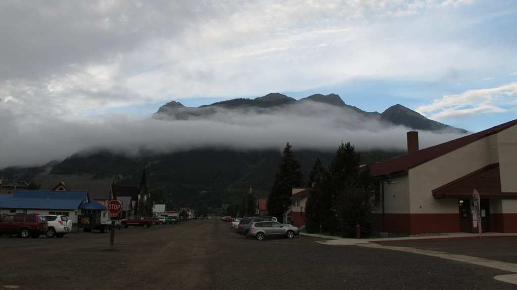 Dragon's breath clouds in Silverton after The Hardrock start (highschool gym is at the right).