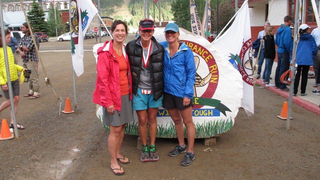 Wearing the berry-colored jacket after Betsy's Hardrock Hundred finish. (Betsy center and fellow pacer Angela on the right.)