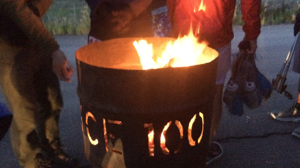 "Warming by the fire pit emblazoned with ""Bryce 100"""