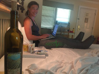 Recovery at its finest: my leggies, wine, chocolate. Receiving text updates about Betsy's race.