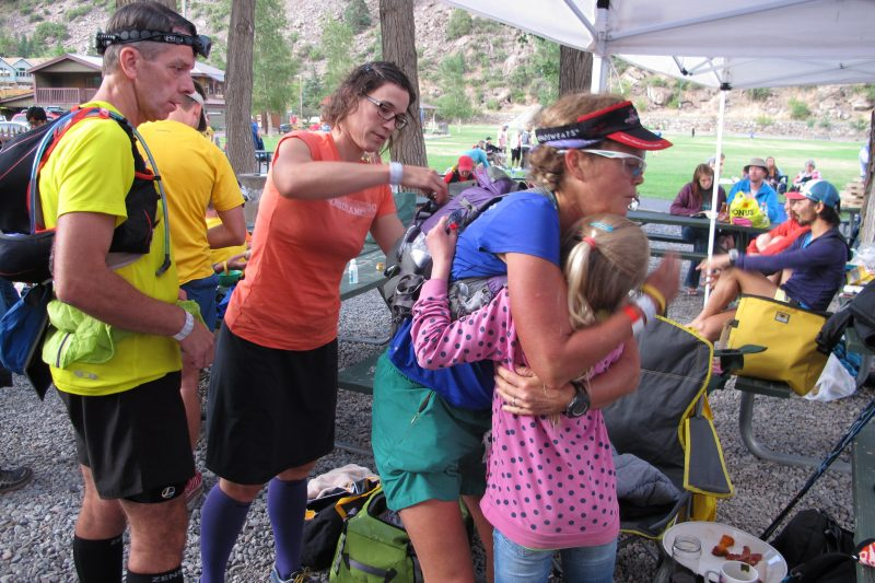 Pacer Jack Meyer looks on as I crew Betsy Nye at Hardrock 100 in 2014. Photo credit: Javier Castellar